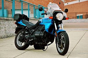 Blue BMW K75 fitted with topbox, parked in a pedestrian area