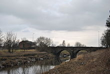 Bank Bridge, the warehouse, which carries the A59 road over the River Douglas