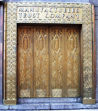 Manufacturers Hanover Corporation - A bronze doorway in the New Yorker Hotel in midtown Manhattan that formerly led to a branch of the Manufacturers Trust Company
