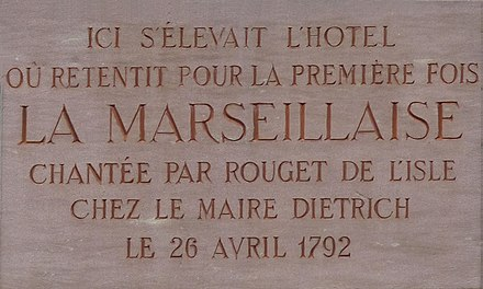 "Commemorative plaque on 3, place Broglie in Strasbourg. Inscription: ""Ici s'elevait l'hotel ou retentit pour la premier fois La Marseillaise chantee par Rouget de L'isle chez la maire Dietrich le 26 Avril 1792"" English Translation: Here stood the hotel where the Marseillaise sung by Rouget de L'isle was heard for the first time by the mayor Dietrich on April 26, 1792 Banque de France-Strasbourg (3)-Marseillaise.jpg"