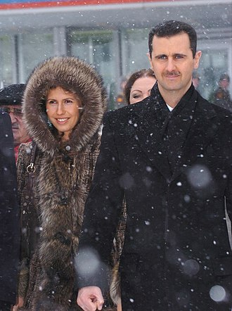 Russian involvement in the Syrian Civil War - Bashar and Asma al-Assad during a visit to Moscow (image taken in 2005)