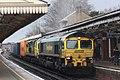 Basingstoke - Freightliner 66520+70010 in a rainstorm going to Crewe.JPG