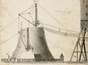 Bell Rock Lighthouse - Shows the lighthouse under construction including half of the temporary beacon that was constructed alongside to accommodate the workers and serve as a temporary lighthouse.