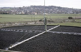 Trickling filter Type of wastewater treatment system with a fixed bed of rocks or similar