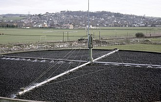 Trickling filter - A trickling filter plant in the United Kingdom: The effluent from the primary settling tanks is sprayed onto a bed of coarse gravel (Benfleet Sewage Treatment Plant)