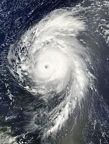 Satellite image of a mature hurricane over the open Atlantic displaying several characteristics of an intense hurricane, including an eye at the center and large spiraling rainbands