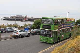 Open top buses in Weston-super-Mare - An open top bus passing Birnbeck Pier