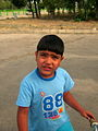 Blue clothed little cyclist boy - cycling near Nishapur railway station 10.JPG