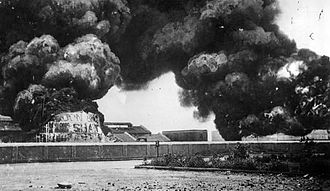 Chennai Port - Oil tanks on fire in the Madras Harbour following the bombardment by German light cruiser Emden on 22 September 1914
