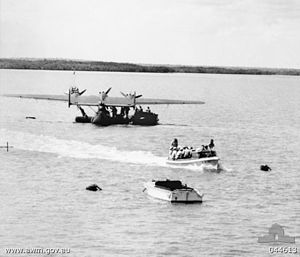 Attack on Broome - Taken in May 1941, several months before the attack on Broome, personnel from a Royal Netherlands Navy Air Service Dornier Do 24 are transported by launch in Darwin Harbour.