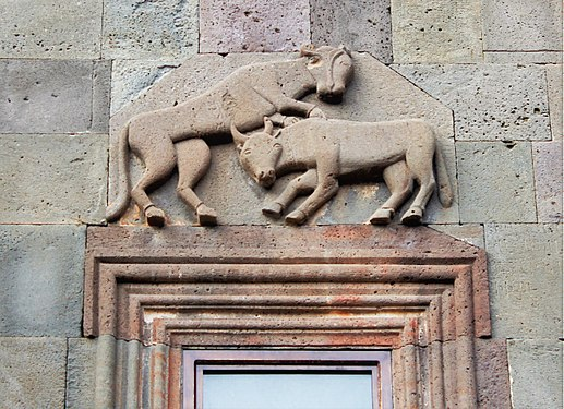 Bull and a lion on the wall of Katoghike Chapel, Geghard Monastery.jpg
