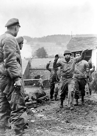American soldiers of the 3rd Battalion 119th Infantry Regiment are taken prisoner by members of Kampfgruppe Peiper in Stoumont, Belgium on 19 December 1944. Bundesarchiv Bild 183-J28619, Ardennenoffensive, gefangene Amerikaner.jpg