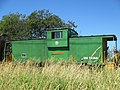 Caboose in train by BP Refinery (7735420124).jpg