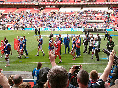 Carlisle United completing a lap of honour at Wembley after winning the Football League Trophy in 2011. CarlisleUnited-JohnstonesPaint.jpg