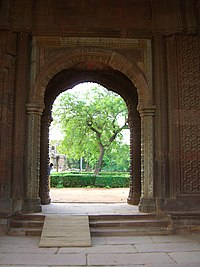 Carved doorway into the Qutb Minar complex.jpg
