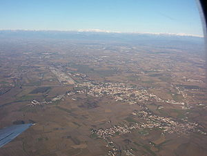 Cervignano del Friuli - Aerial view of Cervignano and Terzo di Aquileia; the Alps in the background.