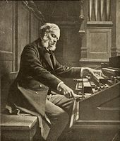 drawing of a grey-haired man with side whiskers playing a pipe organ