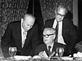 Charles Zimmerman, David Dubinsky, and another man looking over documents at a banquet (5279940824).jpg
