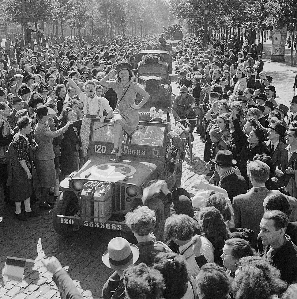 Cheering crowds greet British troops entering Brussels, 4 September 1944. BU483