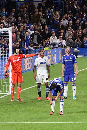 Jermaine Beckford - Beckford (wearing white) playing for Bolton Wanderers against Chelsea in the League Cup in 2014