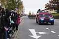 Children wave U.S. flags during the Veterans Day Parade at the Joint Multinational Readiness Center in Hohenfels, Germany, Nov. 8, 2012 121108-A-EL217-004.jpg
