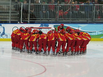 China women's national ice hockey team - The Chinese women's ice hockey team huddles before their game against Russia at the 2010 Winter Olympics.