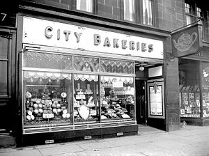 Bakery - Bakery window with breads and cakes on display, 1936