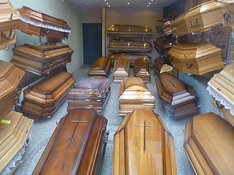 Coffin - A shop window display of coffins at a Polish funeral director's office