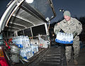 Command Sgt. Maj. Steve Deweese, assigned to Camp Dawson in Kingwood, W.Va., loads water into a vehicle at a Courthouse in Winfield, W.Va., Jan. 11, 2014 140111-Z-LQ742-021.jpg