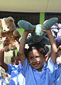 Costa Rican school children gather together after receiving stuffed animals from U.S. Marines and Sailors working with nongovernmental organization Give a Kid a Backpack at Hone Creek School in Hone Creek, Costa 100825-M-PC721-003.jpg