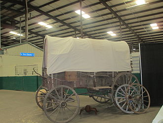 """Joseph Sterling Bridwell - Covered wagon display at """"Cowboy True"""" art show gathering at the J. S. Bridwell Agricultural Center (April 6, 2013)"""