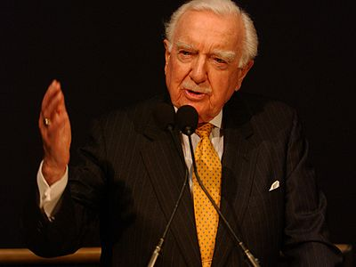 Walter Cronkite speaks at a NASA ceremony in February 2004 Cronkite Columbia tribute.JPG