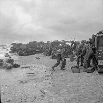 80th Anti-Aircraft Brigade (United Kingdom) - Troops of 3rd Division sheltering on Sword Beach on D-Day, with Bofors gun in background.
