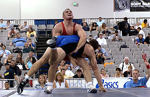 Two men in a Greco-Roman wrestling match.