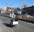 Daddy biking boy past 49th St WSH jeh.jpg