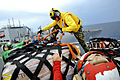 Defense.gov News Photo 110726-N-NY820-190 - U.S. Navy flight deck personnel assigned to the USNS Comfort unpack cargo during a replenishment mission in the Pacific Ocean on July 26 2011. The.jpg