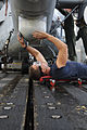 Defense.gov News Photo 111206-N-YM590-029 - U.S. Navy Petty Officer 3rd Class Corey Miller assigned to Helicopter Anti-Submarine Squadron Light 46 washes the underside tail section of an.jpg