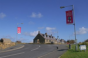 Digital switchover dates in the United Kingdom - Red banners on lampposts in Baltasound remind residents about the digital switchover in The Shetland Islands