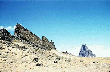 Shiprock, New Mexico, United States: a volcanic neck in the distance, with a radiating dike on its south side Dikes-large.jpg