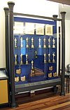 The display case in the lobby of the Walt Disney Family Museum, in San Francisco, displays many of the Academy Awards that Walt Disney won or received. The distinctive, special award which he received for Snow White and the Seven Dwarfs, is at the bottom.