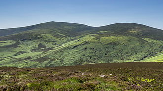 Wicklow Mountains - The pointed mica-schist summit of Djouce (left) contrasts with the rounded granite summit of War Hill (right)