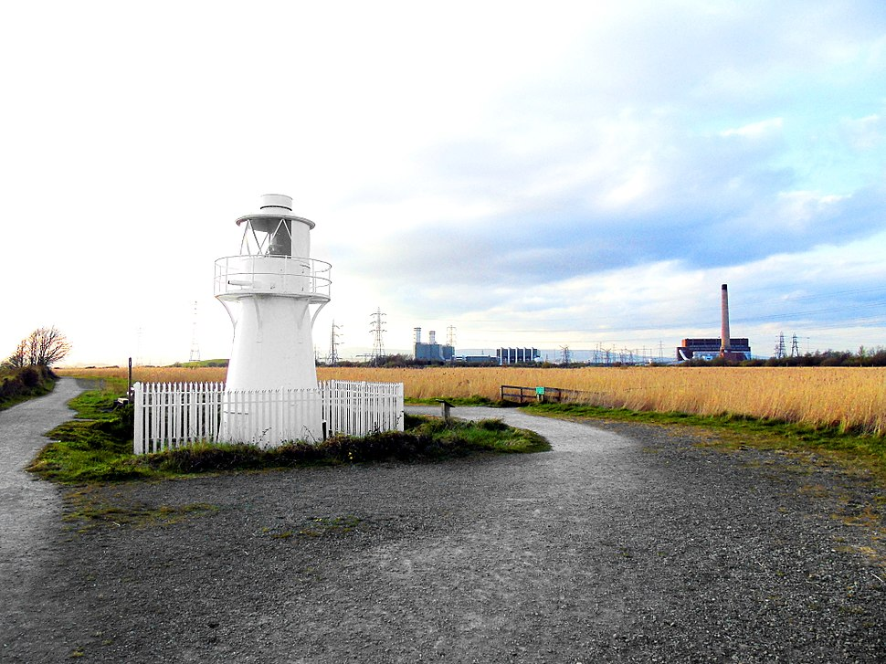 East Usk Lighthouse at Newport Wetlands RSPB Nature Reserve with Floating Walkway in the background to the right