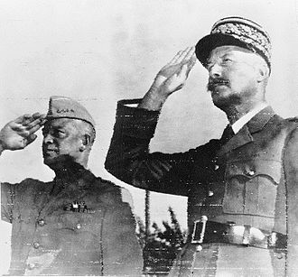 Henri Giraud - Algiers, French Algeria. General Dwight D. Eisenhower, commander in chief of the Allied Armies in North Africa, and General Henri Honoré Giraud, commanding the French Forces, saluting the flags of both nations at Allied headquarters.