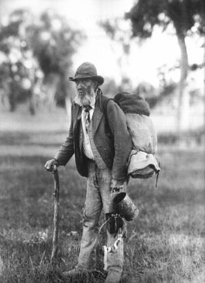 Waltzing Matilda - Photograph of a swagman, c. 1901, holding a billy and carrying a swag on his back