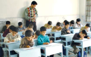 Child care -  Elementary school teacher dictating students (2003, Tehran).