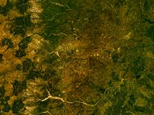 A satellite image of Enugu and other towns that surround it with rivers and hills visible