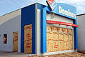 FEMA - 38490 - Boarded up and proteced business building in Texas.jpg