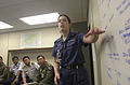 Flag Officer Melissa Dalby, 86 WG, Royal Australian Air Force, presents new scenario data to the squadron leaders of different countries during Pacific Airlift Rally 2001 010911-F-GY993-043.jpg