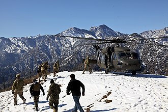 Nari District - U.S. and Afghan National Army (ANA) soldiers preparing to board a UH-60 Black Hawk helicopter at Observation Post Mangol in the Nari district, Kunar province, Afghanistan (February 2012).