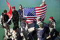 Flickr - The U.S. Army - Soldier celebrates re-enlistment with Iraqi counterparts.jpg